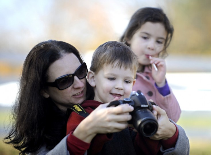 Sara Gunsiorowski helps her children Walter, 3, and Sheila, 6, take pictures of the landscapes at Sagamore Farm. Cassidy Johnson/Baltimore Sun
