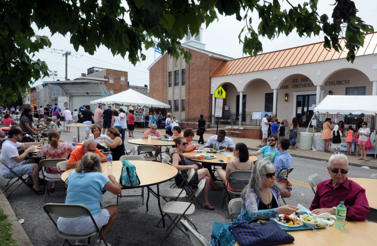 6/8/14: People enjoy food and beverages at the St. Nicholas Greek Folk Festival which was held this weekend on Ponca St. (Algerina Perna/Baltimore Sun)
