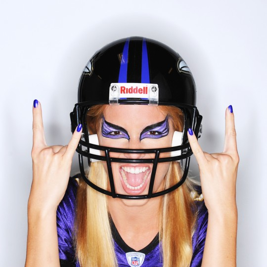 "A Ravens fan celebrates the return of the NFL for this ""b"" cover shot. Model Haley Higgins had her make-up done by artist Leah Sarrah Bassett, both of T.H.E. Artist Agency. (Kenneth K. Lam/Baltimore Sun)"