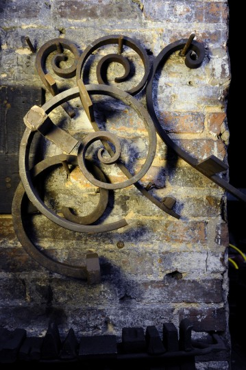 Scrolls hang on a wall at G. Krug & Son Ironworks, the oldest continually run blacksmith shop in the country. (Kim Hairston/Baltimore Sun)