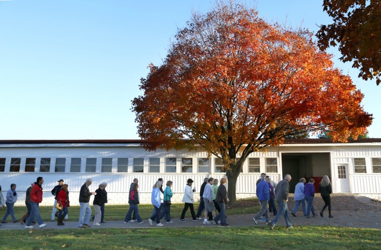 Members of the Three Diamond Club begin a walking tour of Sagamore Farm beginning with the farm's old horse stable. Cassidy Johnson/Baltimore Sun