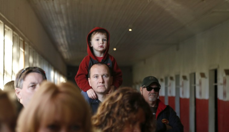 Walter Gunsiorowski, 3, sits on his father, Jim Gunsiorowski's, shoulders while in the old horse stable during a walking tour of Sagamore Farm. Cassidy Johnson/Baltimore Sun