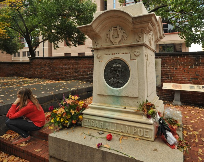 Lenka Slachtova, a researcher at the University of Maryland School of Pharmaceutical Sciences, takes a break near the Poe monument. The burial grounds that surround Westminster Hall are open to the public during daylight hours. Amy Davis / Baltimore Sun