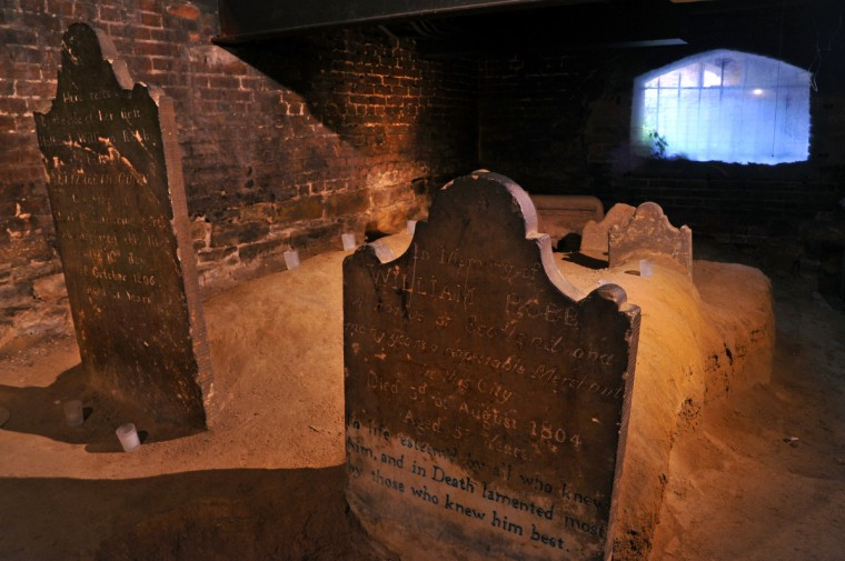 "A pair of gravestones in the catacombs for Elizabeth Gunn, left, who died in 1806, and her first husband, William Robb, who died in 1804. The inscription for William Robb describes him as ""a native of Scotland and many years a respectable Merchant in this city."" He died at 53. Amy Davis / Baltimore Sun"