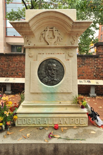 Edgar Allan Poe is buried with his wife Virginia and her mother, Maria Clemm under the marble monument carved by local stonemason Hugh Sisson. This monument at Westminster Burying Ground can be seen from the corner of W. Fayette and N. Greene Streets. Poe's remains were moved from the Poe family plot in another part of the cemetery when money was raised by schoolchildren and others for this 1875 memorial. Amy Davis / Baltimore Sun