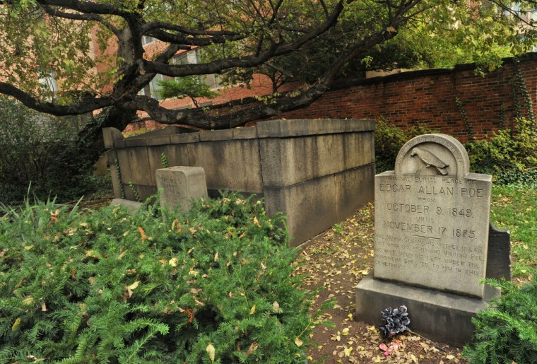 An earlier marker for Edgar Allan Poe is at the south end of the cemetery in the Poe family plot. Poe's remains, as well as those of his wife Virginia and mother-in-law, Maria Clemm, were re-interred under the more prominent marble monument to Poe at the northwest corner of the cemetery. Amy Davis / Baltimore Sun