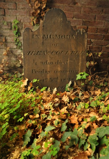 A marker for Alexander Coulter, who died in 1828, is inside the catacombs, but below the porch along the perimeter where ivy has crept in around the grave. Coulter was a saddler who died at age 68. Amy Davis / Baltimore Sun