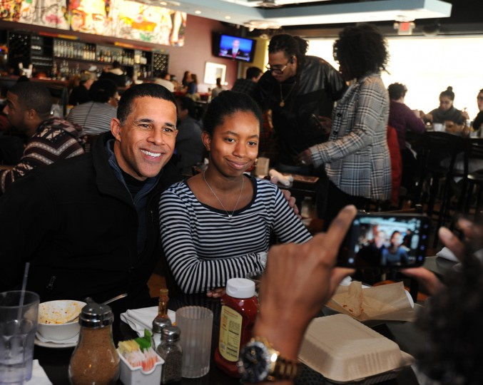 11/2/14: Lt. Gov. Anthony G. Brown campaigns at Busboys and Poets restaurant. Tseder Pretto, aged 13, poses while her mother, Hadja Thiam from Silver Spring, takes her picture with Brown. (Algerina Perna/Baltimore Sun)