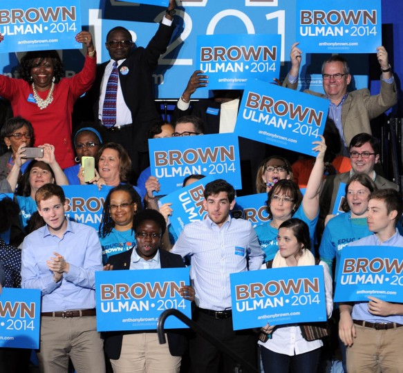 10/30/14- The crowd behind the stage holds up Brown/Ulman campaign signs at Ritchie Coliseum at College Park where Hillary Clinton campaigns for Lieutenant Governor Anthony Brown. (Algerina Perna, Baltimore Sun)
