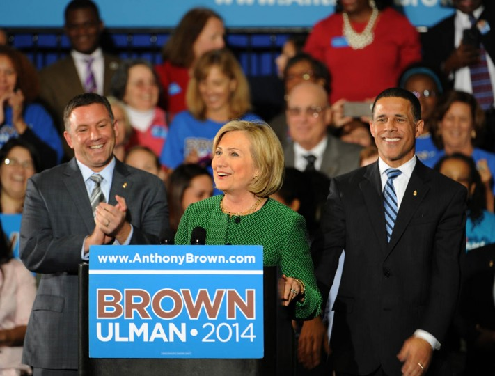 10/30/14- Hillary Clinton, center, campaigns for Lieutenant Governor Anthony Brown, right, at Ritchie Coliseum at College Park. At left is Howard County Executive Ken Ulman, Brown's running mate. (Algerina Perna, Baltimore Sun)