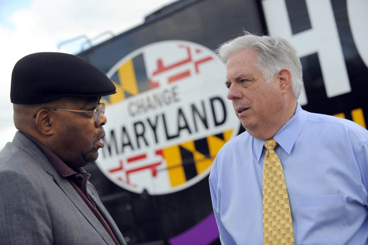 10/30/14-- Larry Hogan, right, the Republican Party gubernatorial nominee talks with Mike Perkins of Overlea this afternoon while he campaigns in Parkville. (Lloyd Fox, Baltimore Sun)