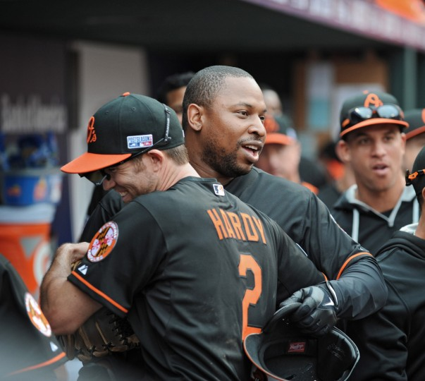 Delmon Young, right, celebrates with J.J. Hardy in the dugout after Young's eighth-inning pinch hit double drove in Hardy for the game-winning run. The Orioles defeated the Tigers, 7-6, in Game 2 of the 2014 ALDS at Camden Yards. (Kenneth K. Lam/Baltimore Sun)