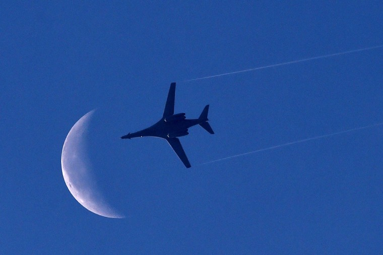 A US Air Force B1-B bomber plane flies above the Syrian town of Kobane, also known as Ain al-Arab as seen from the Turkish border town of Suruc. Turkey is turning a deaf ear to insistent pressure to take a more pro-active stance in the fight against Islamic State (IS) jihadists, adding to existing strains with the West under President Recep Tayyip Erdogan. Western diplomats have repeatedly made clear they want to see the key NATO member play a key role in the coalition against the militants, who are battling for the Syrian town Kobane just a few kilometers from Turkey. (Aris Messinis/Getty Images)