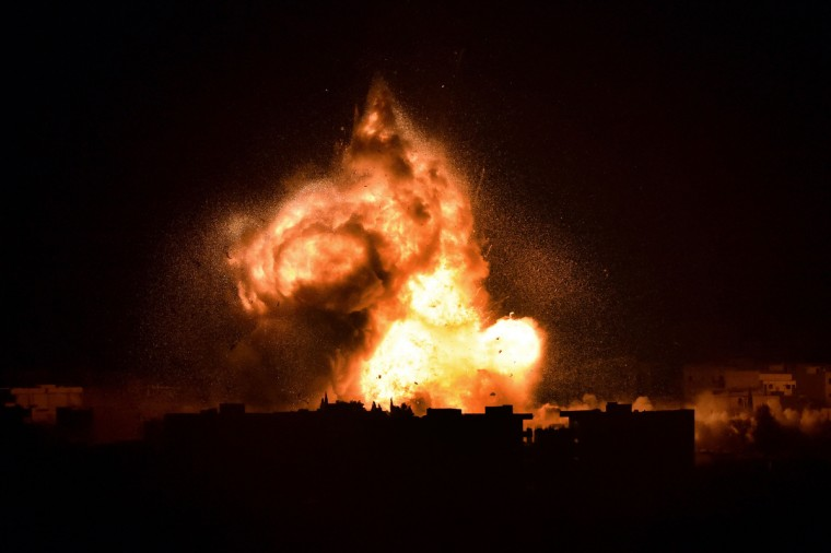 Flames rise from an explosion in the Syrian town of Kobane, also known as Ain al-Arab, after a US-led coalition strike as it seen from the Turkish border in the southeastern village of Mursitpinar, Sanliurfa province. Turkey is turning a deaf ear to insistent pressure to take a more pro-active stance in the fight against Islamic State (IS) jihadists, adding to existing strains with the West under President Recep Tayyip Erdogan. Western diplomats have repeatedly made clear they want to see the key NATO member play a key role in the coalition against the militants, who are battling for the Syrian town Kobane just a few kilometers from Turkey. (Aris Messinis/Getty Images)