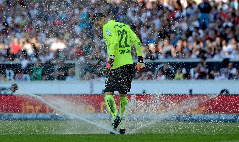 Thorsten Kirschbaum of Stuttgart tries to stop a lawn sprinkler during the Bundesliga match between VfB Stuttgart and Bayer 04 Leverkusen at Mercedes-Benz Arena in Stuttgart, Germany. (Daniel Kopatsch/Bongarts/Getty Images)