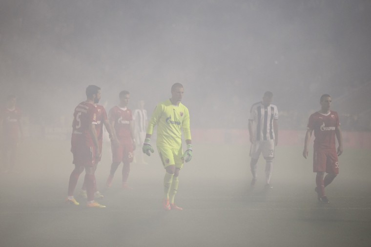 Partizan Belgrade and Red Star players stand in smoke caused by flares during their soccer match in Belgrade. The Serbian derby between bitter Belgrade rivals Partizan and Red Star produced more fireworks on the terraces as fans lit flares four days after a Euro 2016 qualifier was abandoned at the same venue. Play was twice held up for billowing smoke to clear at Partizan's end after their fans set off the pyrotechnics in response to identical action by Red Star supporters shortly before kickoff. (Marko Djurica/Reuters)