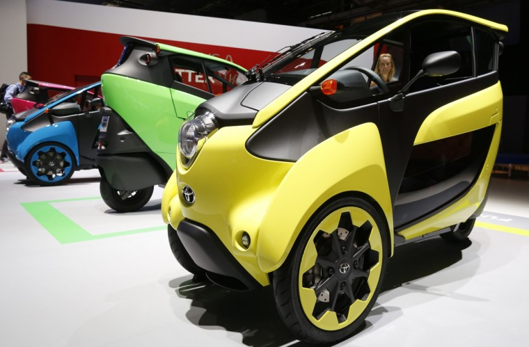 Three wheel design and ultra compact Toyota I-Road electric cars are displayed on media day at the Paris Mondial de l'Automobile, October 2, 2014. The Paris auto show opens its doors to the public from October 4 to October 19. Jacky Naegelen/Reuters photo