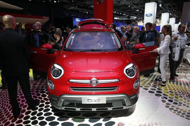 Visitors look at the Fiat 500X car, a compact crossover, displayed on media day at the Paris Mondial de l'Automobile, October 2, 2014. The Paris auto show opens its doors to the public from October 4 to October 19. Benoit Tessier/Reuters photo