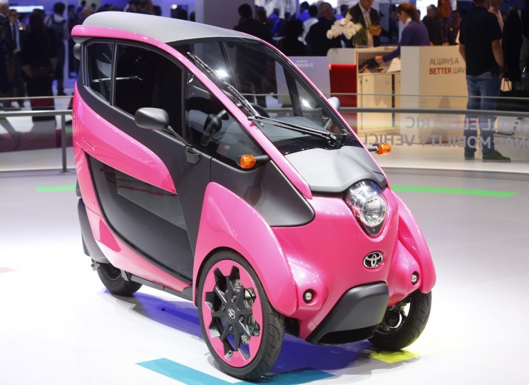 A three wheel design and ultra compact Toyota I-Road electric car is displayed on media day at the Paris Mondial de l'Automobile, October 2, 2014. The Paris auto show opens its doors to the public from October 4 to October 19. Jacky Naegelen/Reuters photo