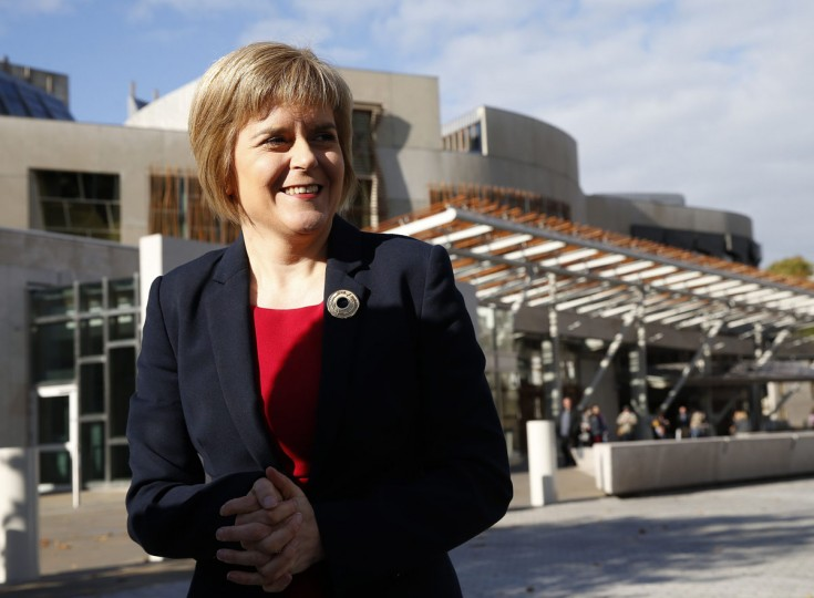 Nicola Sturgeon speaks to the media outside the Scottish Parliament in Edinburgh, Scotland October 15, 2014. Scottish nationalist Nicola Sturgeon will succeed Alex Salmond as leader, the Scottish National Party said on Wednesday after she was the only candidate nominated as party leader. (REUTERS/Russell Cheyne)