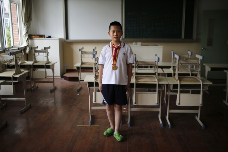 "Only child Wang Qi'an, who was born in 2003, poses for a photograph in Shanghai August 15, 2014. When asked if he would like to have siblings, Qi'an said: ""No because I have investigated all my classmates who have brothers or sisters. None of them perform well in their studies."""