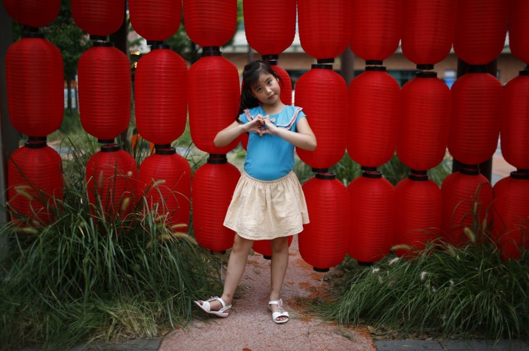 "Liang Xiao, who was born in 2007, poses for a photograph in Shanghai August 24, 2014. ""I want a little sister because little brothers are naughty,"" Xiao said."