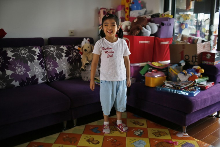 "Only child Liu Ziyu, who was born in 2009, poses for a photograph in Shanghai August 30, 2014. When asked if she would like to have siblings, Ziyu said that she didn't want any ""because my mother would pay full attention to him or her."""