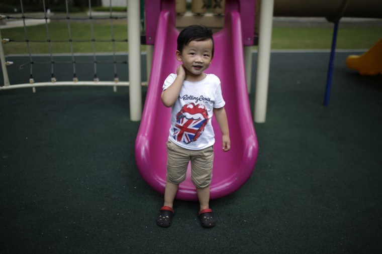 Xin Zhiteng, who was born in 2012, poses for a photograph in Shanghai August 30, 2014. Zhiteng did not say if he would like to have siblings.