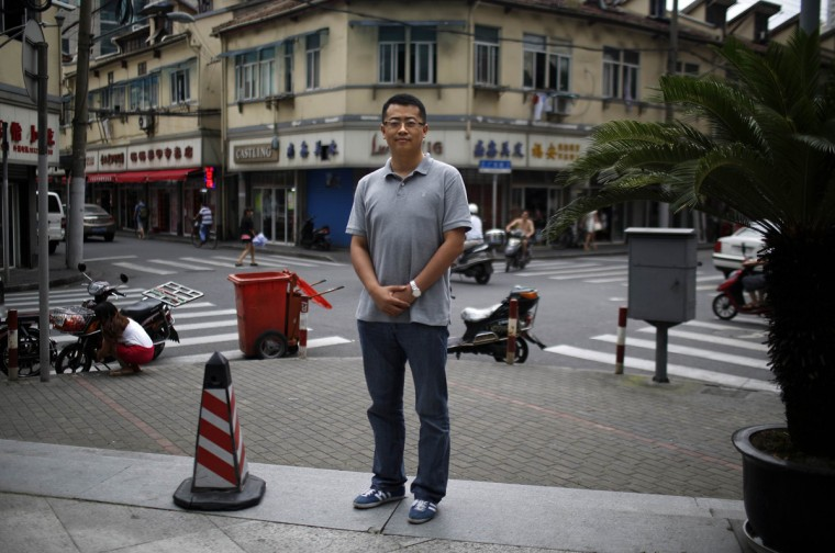 "Zhang Bowen, who was born in 1985, poses for a photograph in Shanghai July 25, 2014. Bowen said: ""I'd like to have a sister or a brother, because I would feel less lonely growing up."""