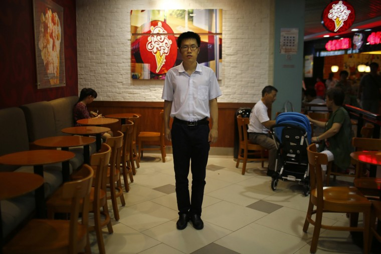 "Zhang Haoran, who was born in 1990, poses for a photograph in Shanghai August 22, 2014. Haoran said: ""Actually it would be a good thing to have brothers or sisters who are of similar age. Then some problems that arise in our adulthood might be solved [more easily]. For example, communication with peers, and also learning sharing, individualism."""