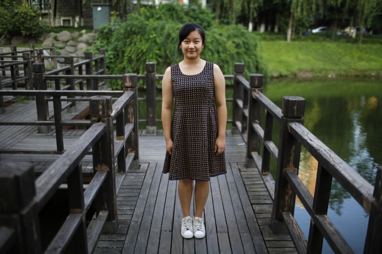"Zhao Mengge, who was born in 1997, poses for a photograph in Shanghai September 6, 2014. ""Yes I'd like to have sisters. Little sisters are not naughty and they are easier to look after,"" said Mengge."