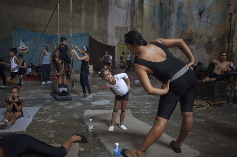 Children warm up during a training session at a circus school in Havana. (Alexandre Meneghini/Reuters)