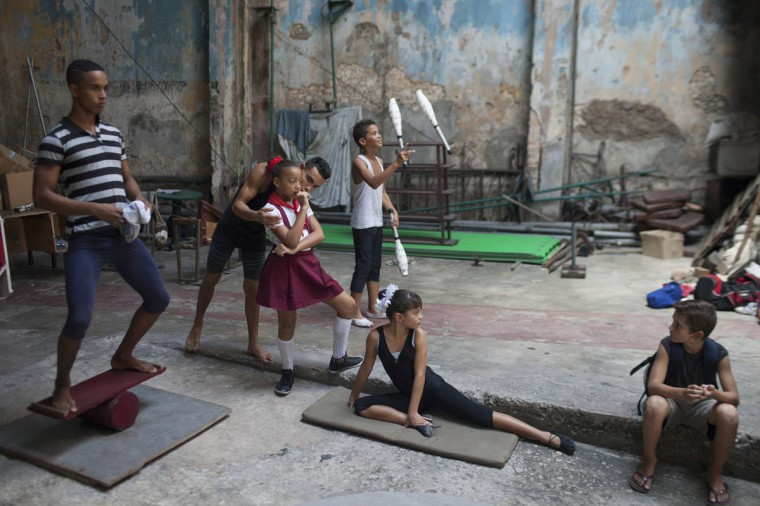 Children practice at a circus school during a training session in Havana. (Alexandre Meneghini/Reuters)