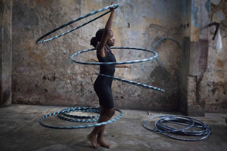 A girl performs with hoops during a training session at a circus school in Havana. (Alexandre Meneghini/Reuters)