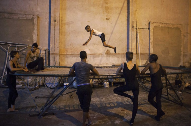 A child practices on a trampoline during a training session at a circus school in Havana. (Alexandre Meneghini/Reuters)
