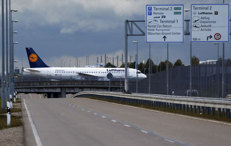 A German airline Lufthansa aircraft taxis along an empty road at Munich airport October 21, 2014. Lufthansa pilots threatened to call further strikes this week after the latest stoppage in a dispute over retirement benefits grounded two-thirds of its flights on Tuesday. (REUTERS/Michael Dalder)