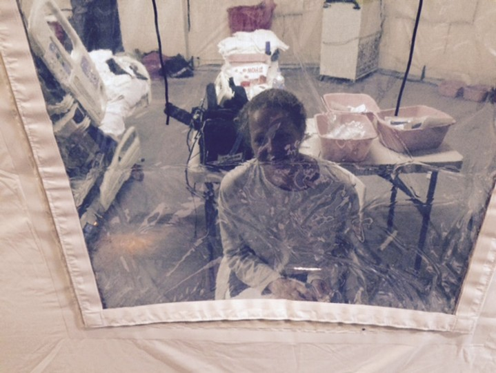 Kaci Hickox, a nurse who arrived in New Jersey on October 24 after treating Ebola patients in West Africa, speaks to her lawyer Norman Siegel from a hospital quarantine tent in Newark, New Jersey, October 26, 2014, in a photo provided by attorney Steve Hyman. Hickox will be allowed to go home, officials said on Monday. The nurse, who is held at a New Jersey hospital under the state's Ebola quarantine policy, didn't present any symptoms and could complete her quarantine at home, state Governor Chris Christie said on Twitter. Picture taken October 26, 2014. (Steve Hyman/Reuters)