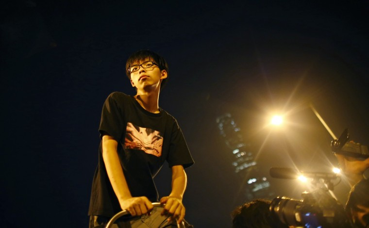 Joshua Wong, leader of the student movement take a pause after delivering a speech to protesters outside of Hong Kong's Chief Executive Leung Chun-ying offices in Hong Kong, October 3, 2014. Hong Kong's leader, Leung Chun-ying, told pro-democracy protesters late on Thursday that he had no intention of stepping down, and warned them that the consequences of occupying government buildings would be serious. Leung, speaking just minutes before an ultimatum for him to resign expired, also said that Chief Secretary Carrie Lam would hold a meeting with students soon to discuss political reforms. He gave no specific time frame. (Carlos Barria/Reuters)