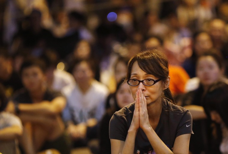 A pro-democracy demonstrator reacts during a speech after the government cancelled talks scheduled for Friday as protesters block areas around the government headquarters office in Hong Kong October 9, 2014. Hong Kong called off talks with protesting students on Thursday, dealing a heavy blow to attempts to defuse a political crisis that has seen tens of thousands take to the streets to demand free elections and calling for leader Leung Chun-ying to resign. (Carlos Barria/Reuters)