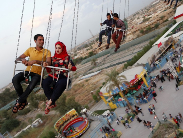 Residents take a ride at an amusement park as they celebrate the Muslim festival of Eid-al-Adha in Baghdad October 5, 2014. Muslims around the world celebrate Eid al-Adha to mark the end of the haj pilgrimage by slaughtering sheep, goats, camels and cows to commemorate Prophet Abraham's willingness to sacrifice his son, Ismail, on God's command. (Ahmed Saad/Reuters)