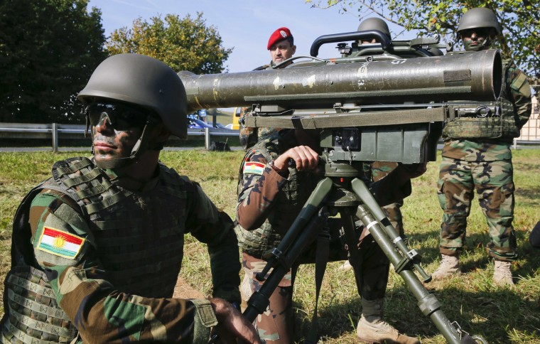 A Peshmerga fighter kneels next to a French-German anti-tank light infantry missile MILAN during a training session at the Bundeswehr army training site of Hammelburg near the northern Bavarian city of Wuerzburg October 2, 2014. German army trains 32 Kurdish Peshmerga soldiers since September 27, 2014 in Hammelburg. (Wolfgang Rattay/Reuters)