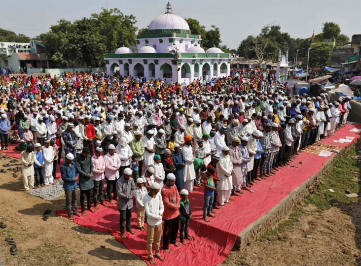Muslims offer a special prayer at the shrine of Qutb-e-Alam, a Muslim saint, on the eve of the Eid al-Adha festival on the outskirts of the western Indian city of Ahmedabad October 5, 2014. Muslims around the world celebrate Eid al-Adha by sacrificial slaughtering of sheep, goats, cows and camels to commemorate Prophet Abraham's willingness to sacrifice his son Ismail on God's command. (Amit Dave/Reuters)