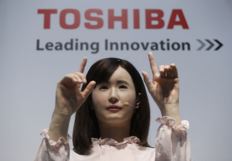 Toshiba Corp. demonstrates its communications android named Ms. Aiko Chihira that can use sign language and introduce itself, at the Combined Exhibition of Advanced Technologies (CEATEC) JAPAN 2014 in Chiba, east of Tokyo, October 7, 2014. Over 500 companies and organisations are exhibiting at CEATEC JAPAN 2014, which will be held until October 11, 2014. (REUTERS/Issei Kato)