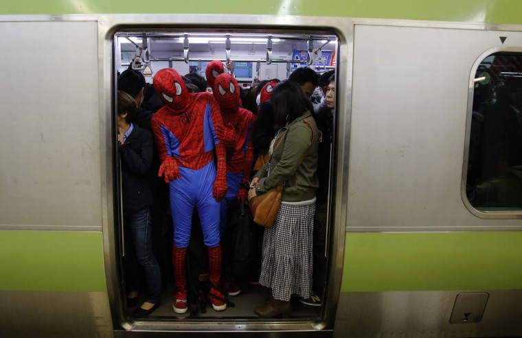 Participants, wearing Spiderman costumes, ride on a train after Halloween night in Tokyo's Shibuya district November 1, 2014. Thousands of costumed revelers descended on Shibuya crossing in downtown Tokyo on Friday to celebrate Halloween in what has in recent years become a incredibly popular Japanese past time. (Yuya Shino/Reuters)