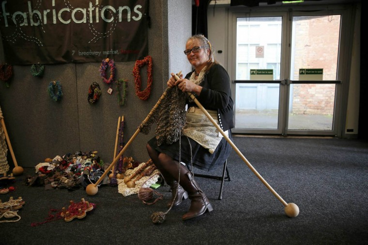 A woman knits with large knitting needles during the Knitting and Stitching show at Alexandra Palace in London, October 8, 2014. The show which includes over 600 exhibitors and 300 workshops is the largest textile and craft event in Britain. (Stefan Wermuth/Reuters photo)