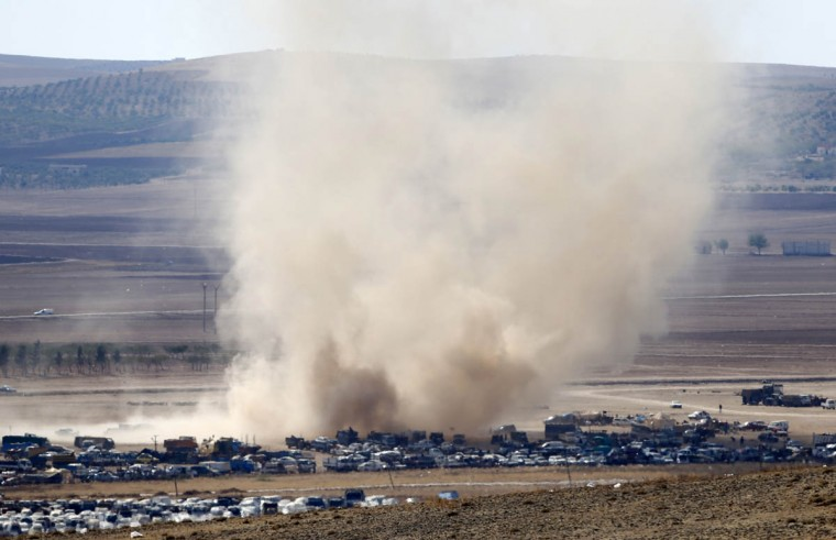 A whirlwind advances towards an area where Syrian Kurds fleeing to Turkey from Syria parked their vehicles in no man's land on the Turkish-Syrian border in the southeastern town of Suruc in Sanliurfa province October 8, 2014. The Pentagon said on Wednesday that a Turkish proposed buffer zone was not one of the military options under consideration as a U.S.-led coalition pursues airstrikes in Syria, but acknowledged it was a subject of discussions with Ankara. (Umit Bektas/Reuters photo)