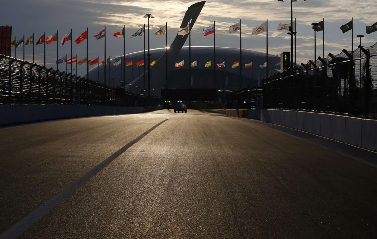 The Sochi Autodrom F1 street circuit is seen with the Olympic Flame and the Bolsoy Ice Dome ice hockey area in the background, in Sochi October 8, 2014. The 2014 Formula One Russian Grand Prix will take place on Sunday. Picture taken October 8. (Laszlo Balogh/Reuters)