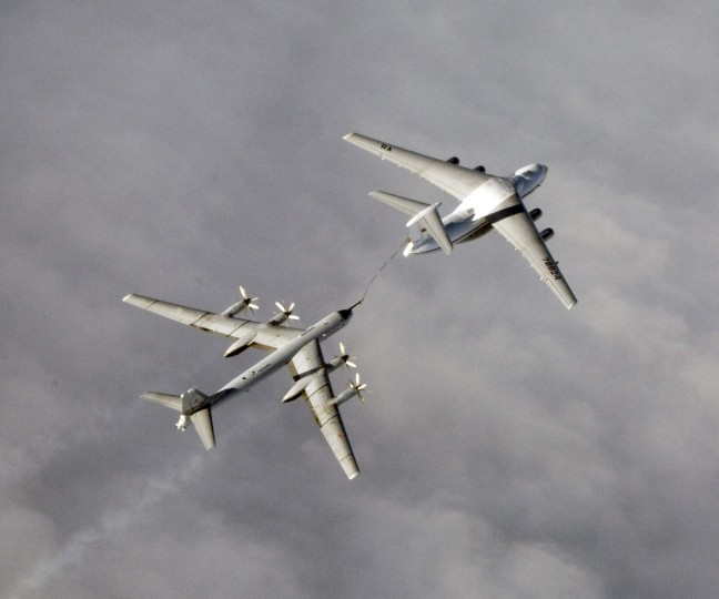 An undated handout photo provided by the Norwegian Army shows a Russian Tupolev Tu-95 strategic bomber refuelling over an unknown location during a military exercise. NATO aircraft tracked Russian strategic bombers over the Atlantic and Black Sea on October 29, 2014 and sorties of fighters over the Baltic in what the Western alliance called an unusual burst of activity at a tense time in East-West relations. REUTERS/Norwegian NATO
