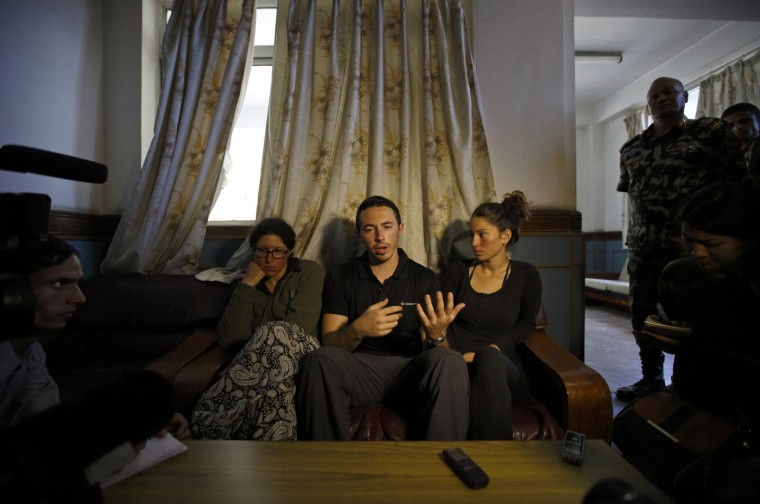 Israeli trekkers Maya Ora (L) along with Yakov Megreli (C) and Linor Kajan (R), who were rescued from an avalanche by the Nepalese army, speaks with the media while undergoing treatment at the Army Hospital in Kathmandu October 16, 2014. Mountain rescue teams in Nepal searched for scores of missing trekkers on Thursday after unseasonal blizzards and avalanches killed at least 20 people along the high altitude Annapurna mountain route popular with backpackers. (Navesh Chitrakar/Reuters)