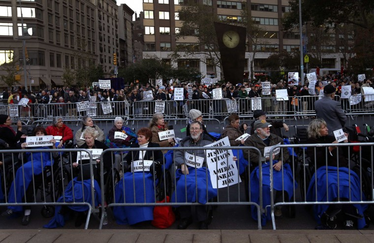 "Protesters sit in wheelchairs during a demonstration across from Lincoln Center and the New York Metropolitan Opera in New York, October 20, 2014. New York's Metropolitan Opera was bracing for its most tumultuous opening in decades on Monday as protestors demonstrated against ""The Death of Klinghoffer,"" the John Adams opera about the 1985 hijacking of a cruise ship by Palestinian guerillas. The opera, seen by some as a humanist masterpiece and by others as anti-Semitic, depicts the murder of Leon Klinghoffer, a Jewish man on a cruise with his wife aboard the Achille Lauro. After his death, the killers threw the body of the retired New Yorker overboard along with his wheelchair. (REUTERS/Mike Segar)"